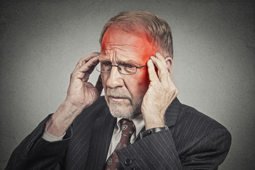headshot senior man suffering from headache hands on head