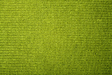 texture of a green knitted fabric