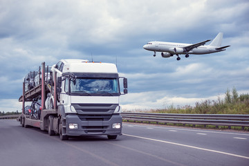 Landing of the passenger plane above the highway.
