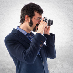 Vintage young man photographing