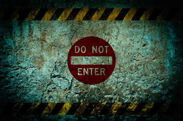 Do not enter warning sign on dirty wall background with grunge a
