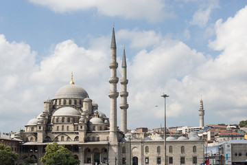 view of the Yeni Cami (New Mosque) from the Bosphorus in Eminönü, Istanbul, Turkey