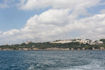view of the Saray Burnu with Topkapı Palace, Sultan Ahmet mosque (Blue Mosque) and Hagia Sofia from the Bosphorus straits, Istanbul, Turkey