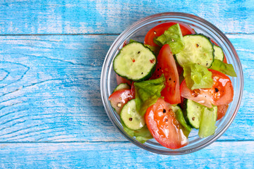 Fresh salad with tomatoes, cucumbers and lettuce