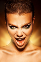 Angry young woman looking at camera and scream