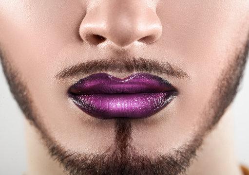 Macro photo of bearded male lips with makeup