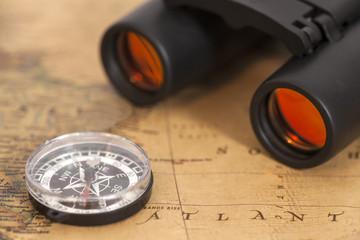 Binocular and compass on map