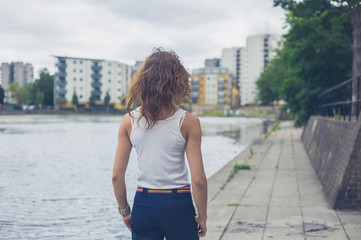 Young woman by marina in urban area