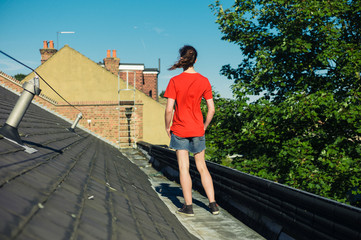Young woman standing on a roof