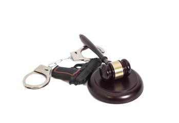 judge's gavel, handgun and handcuffs