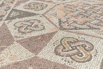 Ancient mosaic floor tiles.