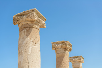 Ancient carved stone columns at an archaeological site in Paphos, Cyprus..