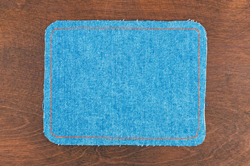 Frame for the text from a blue jeans fabric with the stitched li