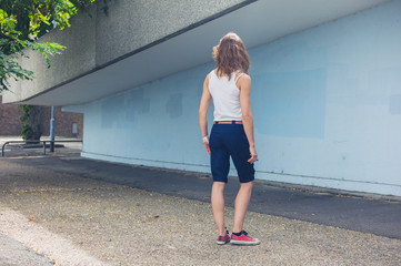 Young woman standing on housing estate