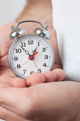 Alarm Clock in male hands close-up
