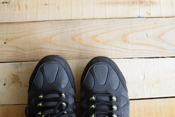 Picture of a pair of sport shoes on wood panels