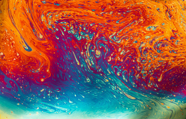 Psychedelic patterns formed on the surface of soap bubbles