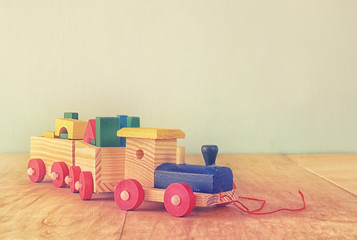Wooden toy train over wooden table