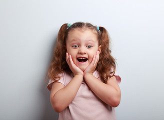 Happy very excited kid girl with open mouth looking. Closeup por
