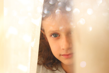 abstract portrait of thoughtful little girl near window