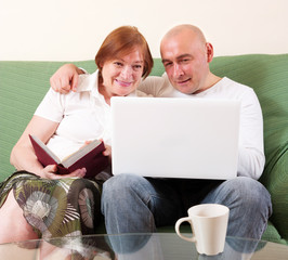 Mother, son and laptop