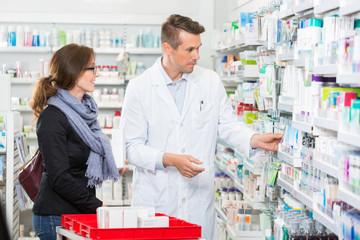 Pharmacist Removing Medicine For Customer