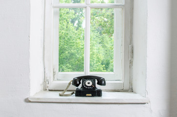 old black vintage phone isolated