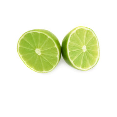 Two halves of a lime fruit isolated over the white background