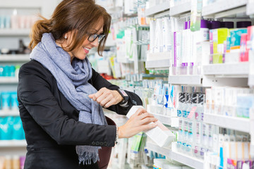 Happy Customer Scanning Product Through Smartwatch In Pharmacy