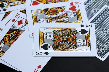 Playing cards on black background