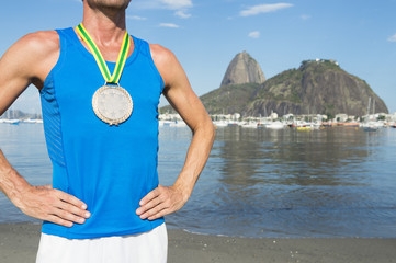 Frst place athlete wearing gold medal standing outdoors at Botafogo Bay Rio de Janeiro Brazil