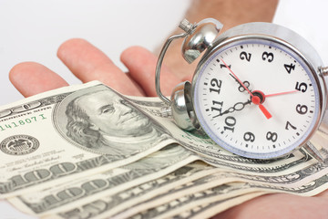 In the man's hand the money and clock. time is money