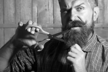 Unshaven man with scissors