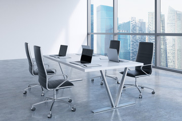 Modern meeting room with huge windows looking at Singapore business city. Black leather chairs and a white table with laptops. 3D rendering.