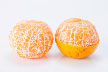 Peeled tangerine or mandarin fruit isolated on white