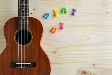 Close up of ukulele on old wooden background