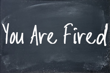 you are fired text write on blackboard