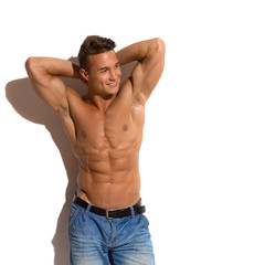 Half Naked Fit Man In Sunlight. Three quarter length studio shot isolated on white.