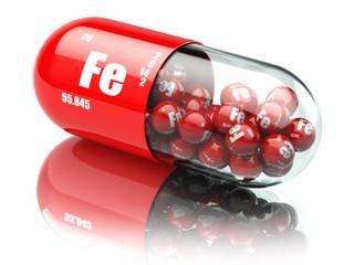 Fototapeta Pills with iron FE element Dietary supplements. Vitamin capsules obraz