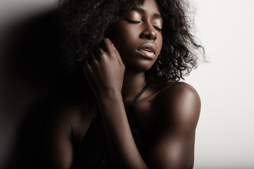 beauty black woman showing a makeup