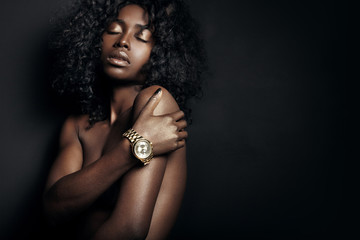 nude black woman with a watch