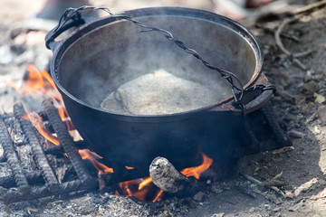 kettle on a fire in nature