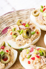 stuffed eggs with tuna, olives and paprika