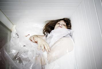 Injured woman in bathtub