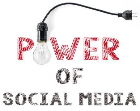 power of social media phrase and light bulb, hand writing Networ