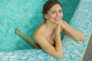 Pretty young woman in the swimming pool