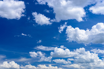 Clear blue sky with white clouds.
