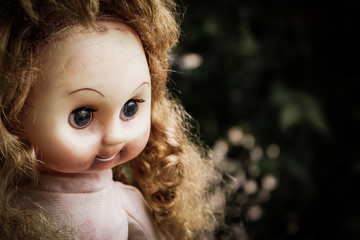 Close up of scary doll face