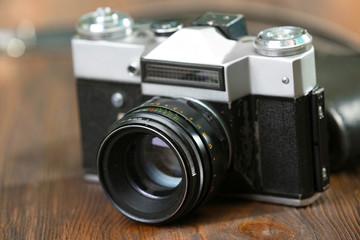 Retro camera on table close-up