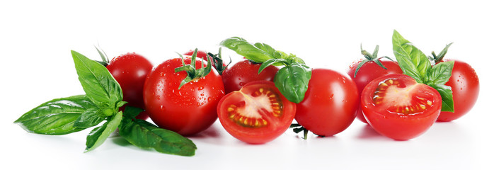 Cherry tomatoes with basil isolated on white
